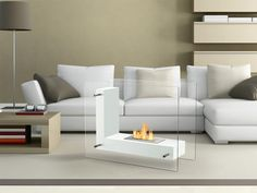 Whether you place it in the den living room or bedroom you'll find yourself enchanted by the welcoming warmth of this Vitrum L White Freestanding Ventless Ethanol Fireplace. It offers a sleek modern look that is well at home in your contemporary decor. With clear glass sides and a white L-shaped inner plate for holding the flame this free standing fireplace design offers you the ease of seeing inside the unit from nearly any spot in your room..