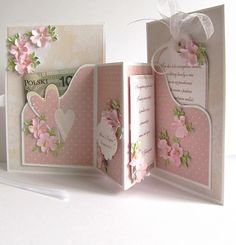 Wedding card made ​​of paper in tulle and lace with a pocket for money. Beautiful