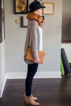 boots + socks + cropped denim + sweater + envelope clutch + scarf + hat.
