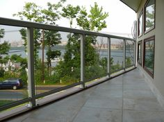 Choosing the Nice Balcony Design: Contemporary Balcony Ceilins With Modern Glass Fence Also Marbel Floors Next To The Victorian Window ~ sagatic.com Balcony Inspiration