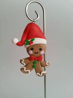 This Handcrafted Polymer Clay Whimsical Gingerbread Man Ornament was made with love and careful consideration to fine details.  This little guy