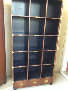 (2) Vintage Solid wood bookcases wrapped in leather with brass fittings $250/each
