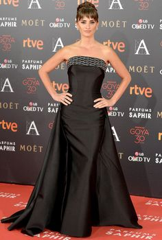 PENÉLOPE CRUZ in a strapless black Atelier Versace gown with a Swarovski crystal neckline, plus Chopard jewels, at the Goya Cinema Awards in Madrid.