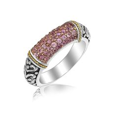 Featuring superb craftsmanship, this ring is designed with vintage style scrollwork pattern and a section with darling pink amethyst accents bordered with 18K y