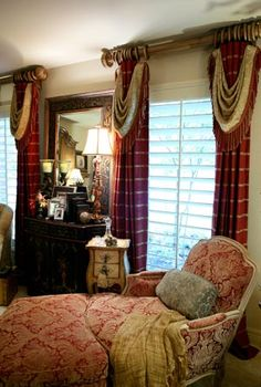 "I don't like the French damask chair with the rest of the room so English, but the drapereis are very well done. The swags on the panels add such a gracious touch & the wood poles are sufficiently ""heavy"" enough to go with the rich red & gold check."