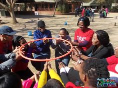 Team building exercise with hoola hoop