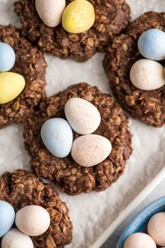 Overhead view of 5 easter nest cookies each with with 3 chocolate cadbury mini eggs