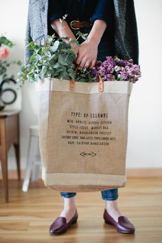 Target customer: she totally gets flowers from the market in a fair trade bag.