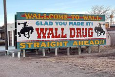 South Dakota Wall Drug Sign After 30 billboards the excitement to see this place builds to an absolute frenzy. Can't say I was disappointed :) Storybook Island, Cross Country Bike, Wall Drug, Places Ive Been, Places To See, Somewhere Down The Road, Roadside Attractions, Vacation Places, Vacations