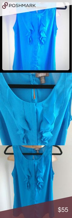 Kenneth cole. Blue. New without tags Blue kenneth cole blouse. Sleeveless. Ruffles in the front. Kenneth Cole Reaction Tops Blouses
