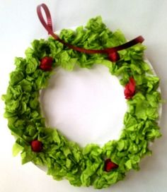 Paper Plate Wreath with green tissue and red pom poms