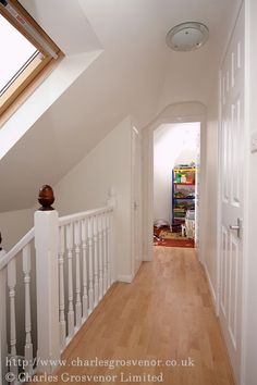 Visualise landing in attic conversion.  Like the idea of being open to lower floor with railings so upstairs won't feel as isolated.