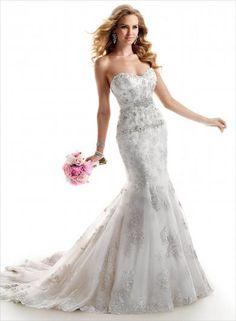 9f9d986882a7 Maggie Sottero Ainsley - elegantné svadobné šaty bohato zdobené luxusnou  vyšívanou čipkou