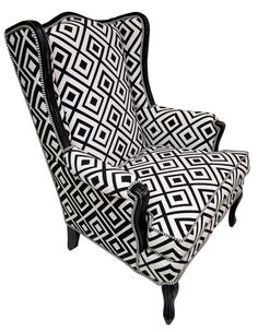 BLACK AND WHITE GEOMETRIC CHAIR. We turned a ho-hum classic into contemporary wow! We found the original classic wing chair lost in a stately house. First, we tossed the faded brown velvet, then hand painted black and white, hand distressed and buffed. We upholstered in a bold black and white diamond geometric. Black on white for the interior and reversed white on black for the exterior. Then, welted it with a crisp, coordinated pinstripe. Heaven! Fully restored through the Pentimento…