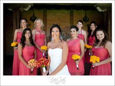 SO much to love in this picture...LOVE the pink (guess gray has some competition), love how the all of the bridesmaid's dresses are different, and love how the maid of honor's bouquet is different from the rest (the bride's bouquet is the very prettyyy)