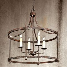 """Dimensions: 24"""" x 24"""" x 28"""" This aged finish iron pendant is so stunning. Comes with a canopy and 42"""" chain. Minimum bulb wattage is 25 per bulb socket."""