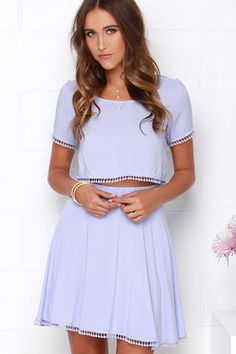"""As Seen On Amy of Straight A Style blog! A match made in heaven, the Lovely Com-Beau Lavender Two-Piece Dress is turning heads wherever it goes! A cute woven, rayon top with scoop neckline has short sleeves, and a cropped bodice trimmed in darling crocheted pompoms. The matching skater skirt has a wide, elasticized waistband and more crocheted accents! Top is unlined; skirt is lined. Small top measures 15.5"""" long. Small bottom measures 17.5"""" long. 100% Rayon. Hand Wash Cold. Imported."""