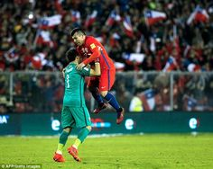 Gary Medel jumps on team-mate Claudio Bravo following Sanchez's last-gasp winner