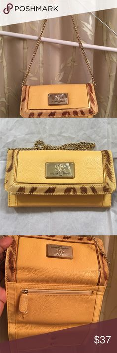 """Original Sharif Clutch Sharif Genuine Pebbled Leather Clutch & Man made materials. Color is Buttercream. Removable gold tone chain is approx. 9""""L, several inside CC pockets, Checkbook Holder, Pocket for Cash (bills) outside zip pocket for coins. Inside lining 100%polyester. Soft & Supple, Beautiful color with man made fur trim print. New never used. Sharif Bags Clutches & Wristlets"""