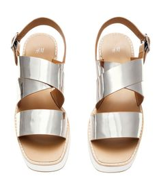 Check this out! Platform sandals in imitation leather. Straps with metal buckle at ankle. Rubber soles. Platform height 1 3/4 in. - Visit hm.com to see more.