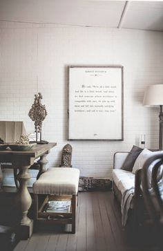 "The home accessories store, FABLE + FLAME in Lexington, KY creates and sells a framed, blown-up book page. I think it wouldn't be to hard to get something similar from a DIY project. UPDATE: I'm going to do a copycat of this project with the poem, ""Invictus"" by William Ernest Henley."