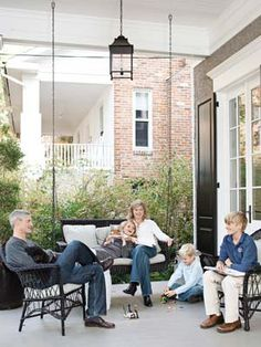 Family Front Porch - - The large front porch of this Washington, D.C., home is a family gathering space.