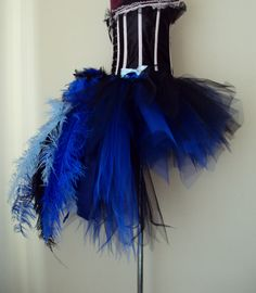 Burlesque Peacock skirt in Royal Blue ,Blue and Black  with feathers and ostrich plumes this can be made in different sizes please just ask ?