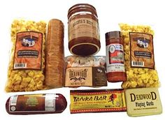 Deadwood, SD is named after the dead trees that are found in its gulch. Get a taste of the delicious local South Dakota with Dakota candies, pecan almond crunch, Deadwood cards, seasonings, Native Grounds cheese, sausage and crackers.
