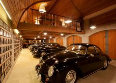 Luxury garage interiors cave by twist interior design for Luxury garage interiors
