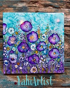 work of art by Yaki ... bright and beautiful flowers in purple and turquoise .... looks like alcohol inks on white ceramic tile ...
