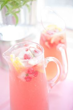 Pitchers filled with a sweet pink drink make this summer bridal shower especially fresh. #Weddings