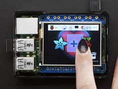 """Adafruit PiTFT 2.4 - It features a 2.4"""" display with 320x240 16-bit color pixels and a resistive touch overlay. The HAT uses the high speed SPI interface on the Pi and can use the mini display as a console, X window port, displaying images or video etc. Best of all it plugs right in on top!"""