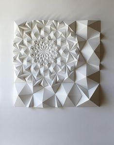 Matt Shlian is an artist, paper engineer and teacher. Beginning with an initial fold, a single action causes a transfer of energy to subsequent folds, which ultimately manifest in drawings and three dimensional forms.: