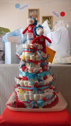 Thing 1 Thing 2 Diaper Cake : Everyone's favorite Dr. Seuss hooligans have never looked quite as fun! This Thing 1 Thing 2 Diaper Cake ($200) is brimming with fun lil gifts for the baby.