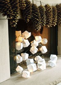 Origami xmas light covers. I'd love to do these with rice paper :)