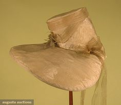 """Cream silk bonnet, American, c1829; Moire silk faille with widely spaced floral satin stripe, cream silk gauze ribbon trim, high crown set at angle to wide face framing brim, buckram linings, Crown Ht 8"""", Brim Wd 20"""""""