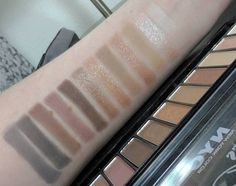 Swatches of the NYC new york color Lovatics by Demi eyeshadow palette in the shade natural. It's only $6.99 at Target, and it's a pretty good dupe for the Urban Decay Naked 1 palette!