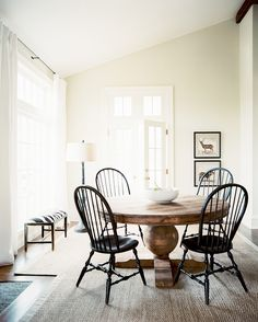 Dining Room Photo - Black Windsor dining chairs surrounding a round wooden table