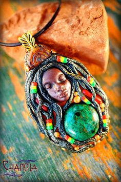 Tiny Rasta Lady Oshun Rasta Love Pendant-Goddess by ChaNoJaJewelry.  This tiny Rasta Lady is something a little different. I got inspired by dear Sabali to create more Rasta Love Pieces. It was so much fun to make another one and I don't think I can ever stop making them :) She is really unique, nowhere else to be found. In this piece I combined the Rasta Colors Red Gold Green and I just loved to sculpt the tiny rasta dreadlock beads she wears!