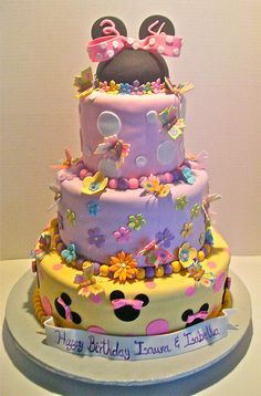 Minnie Mouse Cake ~ Love this cake and all the colors...would be easy to incorporate Daisy into this Bow-tique cake