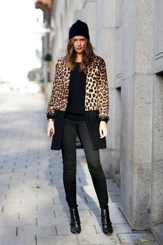 Caroline Blomst // black beanie, leopard contrast coat, sweater, skinny jeans and boots #style #fashion #winter