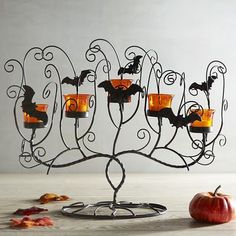 Create a spooky, swirly tablescape with our wrought iron centerpiece decorated with fun bats and interesting shapes. Add pumpkins and…