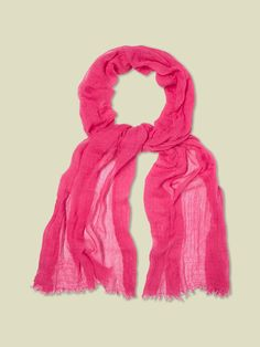 Our lightweight Dreaming Away scarf is back and it's skinny! This luxuriously soft scarf has fringed edges and looks great paired with casual tops.