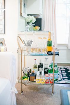 Cat Cantrell's Houston Garage Apartment Tour #theeverygirl #barcart #styling