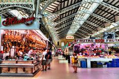 One of the best markets in Valencia, Mercado Central impresses visitors with its magnificent architecture and high-quality local delicacies. Central Market, Valencia, Times Square, Spain, Architecture, Travel, Image, Drink, Food