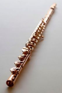 Flute gold. Much want
