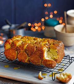 Monkey bread is made by stacking small dough balls into a loaf tin and layering them with banana and cinnamon syrup - a decadent breakfast hailing from America.