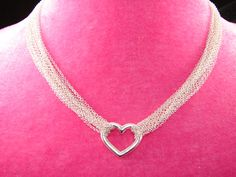 What a timeless and classic piece! This beautiful designer inspired chained heart necklace