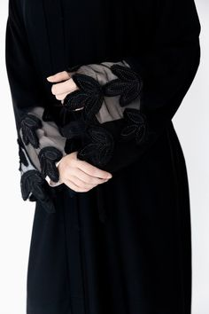 The Tulip Net Abaya is the epitome of feminine occasion-wear and is intricately crafted with black net and embroidery. Matching scarf and belt included. Arab Fashion, Muslim Fashion, Mode Abaya, Hijab Fashionista, Pakistani Dresses Casual, Abaya Designs, Hijabi Girl, Hijab Styles, Hijab Chic