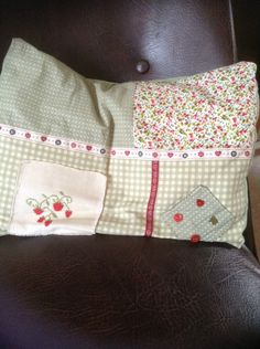 I had to put my strawberry cross stitch to use, so I made it into a patchwork cushion.